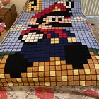 Finally finished my son's blanket!! Thankgod he still loves Mario it took me 2+ years!!