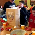 Little bro had been saving up for a PS4, so big bro surprises him with one on his birthday